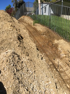 Cemetery drainage ditch. Precision Set-Up digs deep every time.