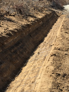 Trenching to perfection for efficient water runoff. Vditch.com V-ditch